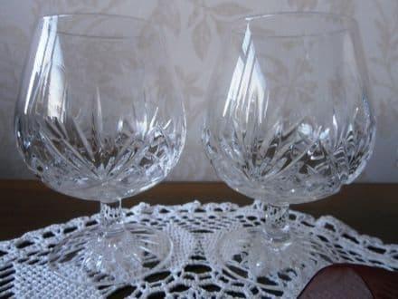 Brandy balloons, cut glass pentagon pattern in bowl