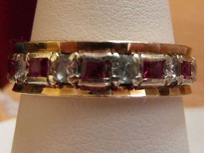23E LADIES 9CT GOLD VINTAGE RUBY AND ZIRCONIA FULL ETERNITY RING SIZE S