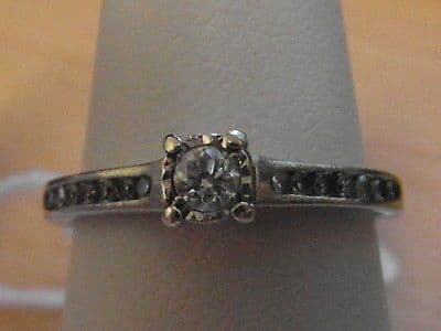 733E LADIES 9CT WHITE GOLD 1/4 CARAT DIAMOND SOLITAIRE WITH ACCENTS RING SIZE O