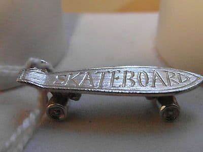 771E VINTAGE LADIES STERLING SILVER SKATEBOARD CHARM
