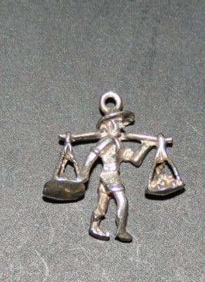 SOLID SILVER CHINESE MAN CARRYING FOOD CHARM
