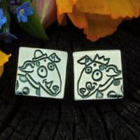 Dog with hats ear studs, polished silver